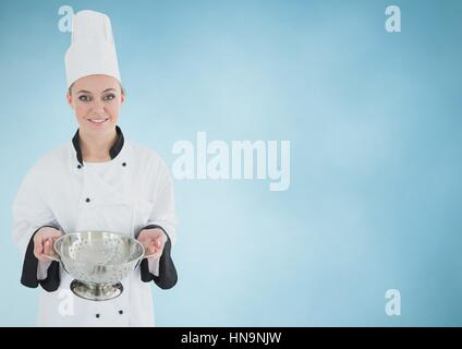 Digital composite of Chef with sieve against blue background - Stock Photo