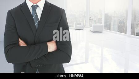 Digital composite of Businessman torso in the neutral white room - Stock Photo
