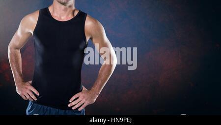 Digital composite of Fitness Torso against dark blackground - Stock Photo