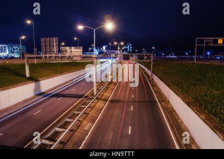 Asphalt road is lit at night. - Stock Photo