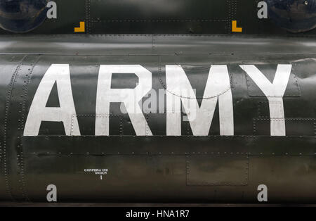 US Army insignia on the side of a vintage Vietnam war helicopter - Stock Photo
