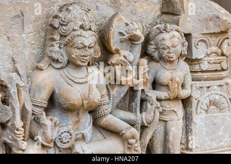 A broken sculpture of Goddess Durga at the Chand Baori stepwell in Abhaneri, Rajasthan, North India. - Stock Photo
