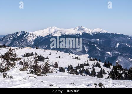 Martinske hole (Martinky) ski resort with Krivanska Mala Fatra mountain range on the background and clear sky in - Stock Photo