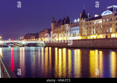 Conciergerie at night, Paris, France - Stock Photo