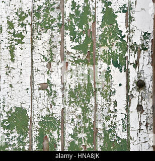 Weathered and peeling paint on a old timber door - Stock Photo