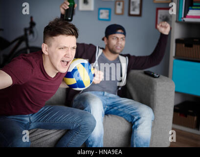 Young men stressing out while volleyball game - Stock Photo