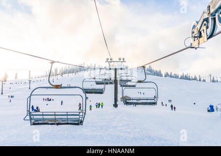 beautiful ski lift over snow mountain in ski resort with blue sky background. - Stock Photo