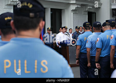 Philippine President Rodrigo Duterte addresses a group of police officers facing charges of corruption to be resigned - Stock Photo