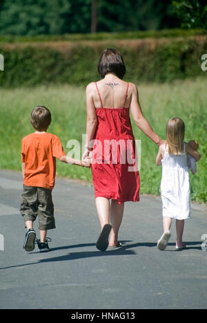 Junge Mutter mit zwei Kinder - mother with two children - Stock Photo