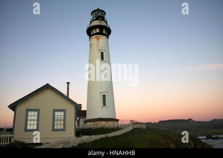 Historic light house on the coast of Northern California at Sunset, sun setting behind the light house - Stock Photo