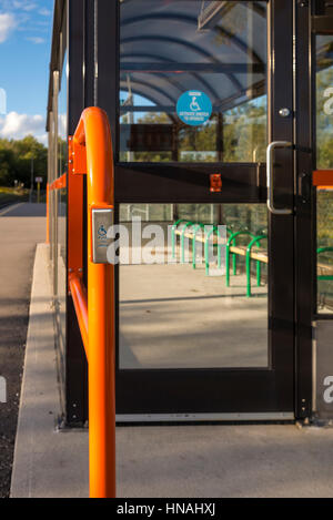 A handicap push to open button outside the shelter at the commuter train station in Stouffville Canada. - Stock Photo