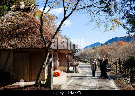 Tourists in Toganoki chaya, Nonaka Village, Kumano Kodo, Nakahechi route, Tanabe, Wakayama, Kinki, Japan - Stock Photo