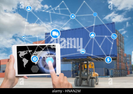 Hand holding tablet is pressing button Logistics connection technology interface global partner connection for logistic - Stock Photo