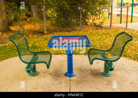 Game Table at Local Park in Fall - Stock Photo