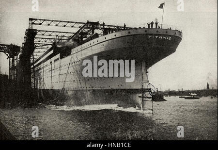 The Titanic being built.  This photo has been represented as the Titanic, and clearly says as much, but quite probably - Stock Photo