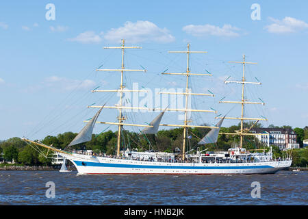 Hamburg, Germany - May 8, 2016: Russian three-masted sailing ship MIR on the Elbe river during the departure parade - Stock Photo