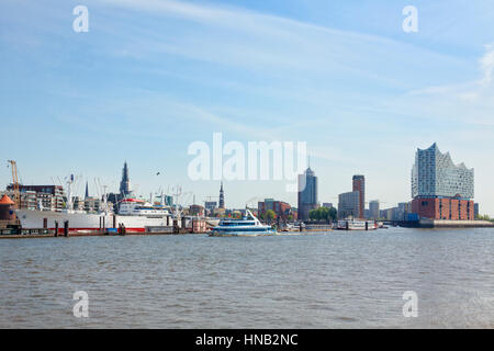 Hamburg, Germany - May 19, 2016: Waterfront from St pauli piers with museum ship Cap San Diego to HafenCity quarter - Stock Photo