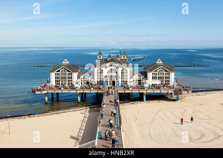 Sellin, Germany - September 22, 2016: Tourists visiting the historic pier at the Baltic Sea beach on the island of Ruegen.