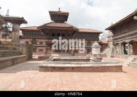 Scene from Bhaktapur square with a water tank in the foreground, in Kathmandu, Nepal - Stock Photo
