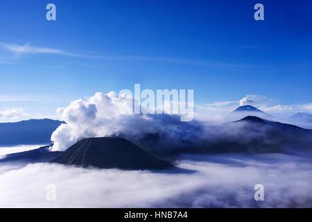 Volcanoes seen from Mount Penanjakan Indonesia. - Stock Photo