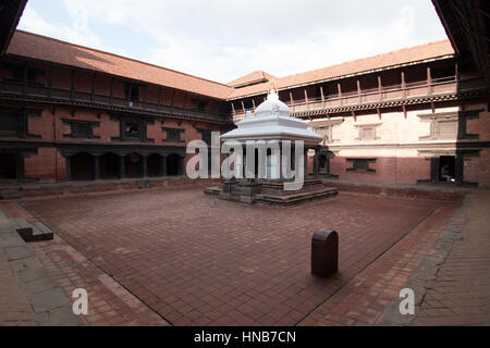 Courtyard of a building built in the traditional Nepalese style in Bhaktapur, Kathmandu - Stock Photo