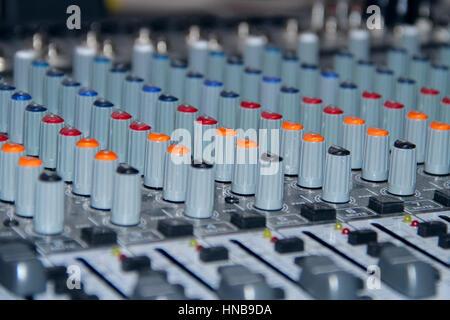 A mixing console shot in studio closeup - Stock Photo