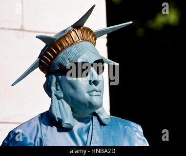 A street entertainer dressed up as the statue of liberty poses for tourists outside central Park in manhatten, New - Stock Photo