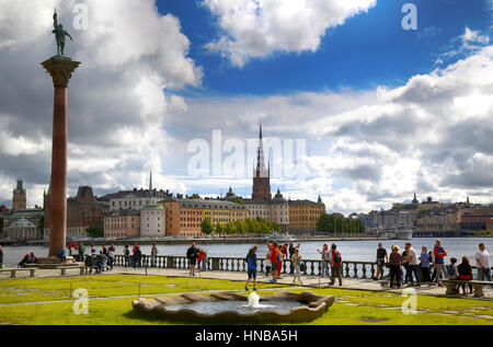 STOCKHOLM, SWEDEN - AUGUST 19, 2016: Tourists walk and visit Stockholm City Hall ( Stadshuset ) and View of Gamla - Stock Photo