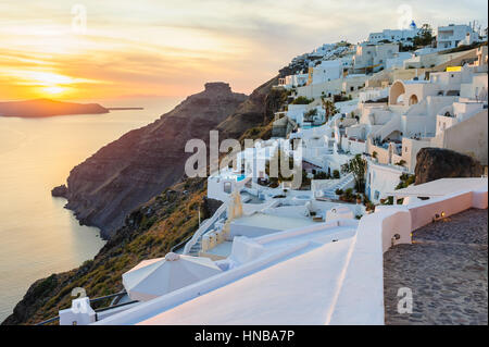 Oia luxury decks and patios at sunset - Stock Photo