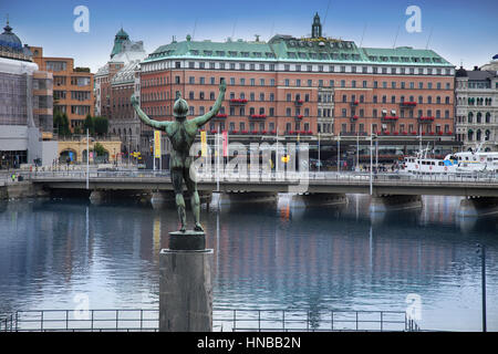 STOCKHOLM, SWEDEN - AUGUST 20, 2016: View of luxury hotel Grand Hotel at Stockholm waterfront and Sun Singer Statue - Stock Photo