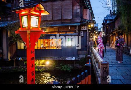 Women, Street scene, in Shirakawa-minami-dori, Gion district, Kyoto. Kansai, Japan. - Stock Photo