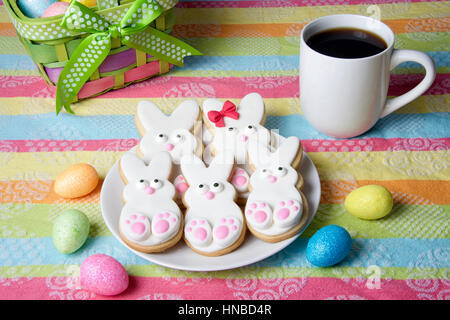 Easter Bunny Sugar Cookies homemade covered in home made marshmallow fondant, decorated with candy eyes, nose, feet - Stock Photo