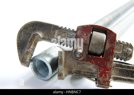 pipe wrench with water pipes on white background - Stock Photo