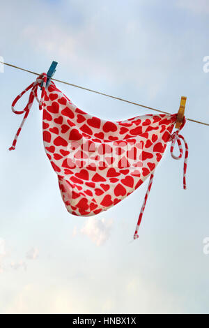 Bikini bottoms hanging on a clothes line - Stock Photo