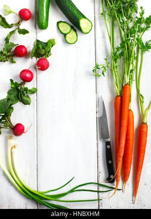 Fresh vegetables on white wooden table - Stock Photo