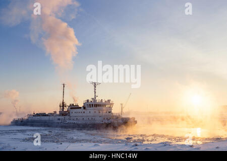 Ice Breaker Breaks Ice at Sunset. - Stock Photo