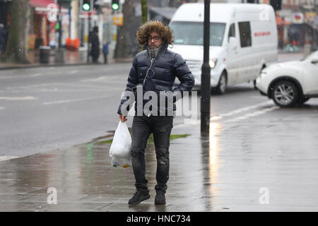 North London, UK. 11th Feb 2017. Shoppers out in the rain and sleet showers in North London. Credit: Dinendra Haria/Alamy - Stock Photo