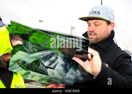 Gosport, Hampshire, UK. 11th February 2017. Alex Thomson arriving back in his home town of Gosport on board HugoBoss - Stock Photo