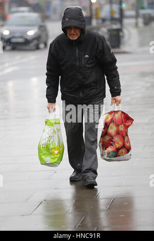 North London, UK. 11th Feb, 2017. Shoppers out in the rain and sleet showers in North London. Credit: Dinendra Haria/Alamy - Stock Photo