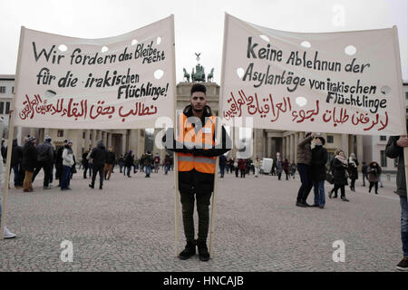 Berlin, Berlin, Germany. 11th Feb, 2017. A small group of protester in front of the Brandenburg Gate rally against - Stock Photo