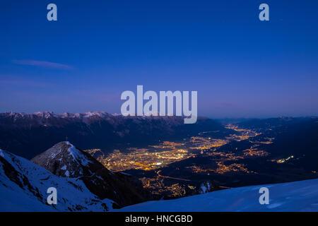 Inntal at dawn, Nordkette at back, illuminated Innsbruck, Spitzmandl mountain in front, blue hour, Innsbruck, Tyrol, - Stock Photo