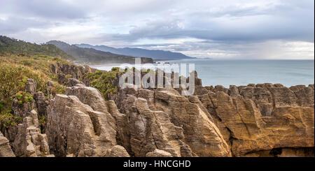 Sandstone rocks, rock formation Pancake Rocks, Paparoa National Park, Punakaiki, West Coast, New Zealand - Stock Photo