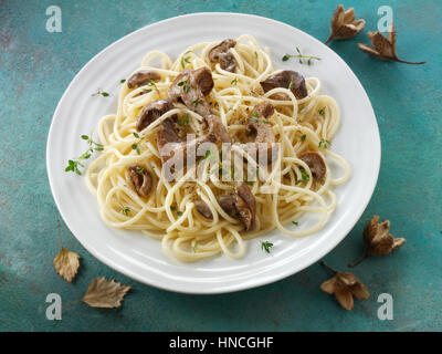 Sauteed wild organic Pied Bleu Mushrooms (Clitocybe nuda) or Blue Foot mushrooms cooked in butter with spaghetti - Stock Photo