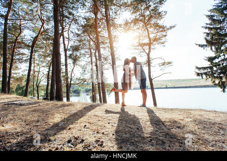 Romantic couple on the beach at colorful sunset  background - Stock Photo