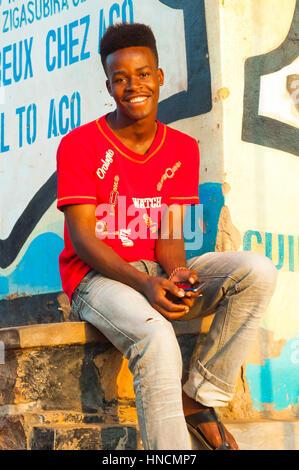 Young man in main street, Nyamirambo, Kigali, Rwanda - Stock Photo