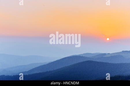 Thick fog and sunrise in the mountains. Carpathians. Ukraine. Eu - Stock Photo