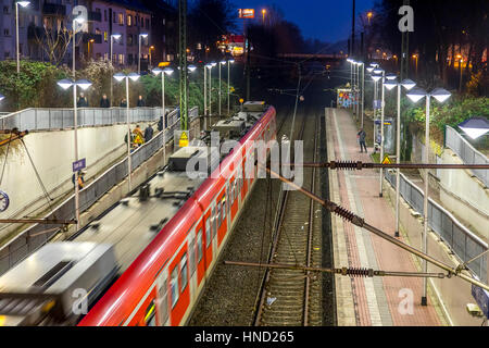 S-Bahn train, local train, in  S-Bahn station, local transport, evening, train station Essen-SŸd, line S6, Germany - Stock Photo