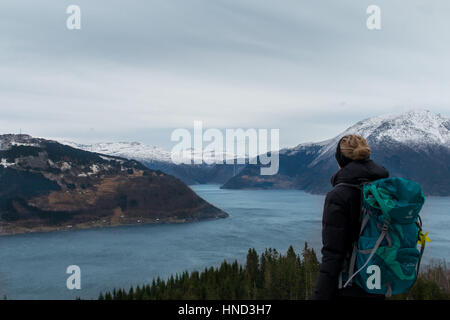 Norway hardanger fjord blonde woman looking from the mountain in winter