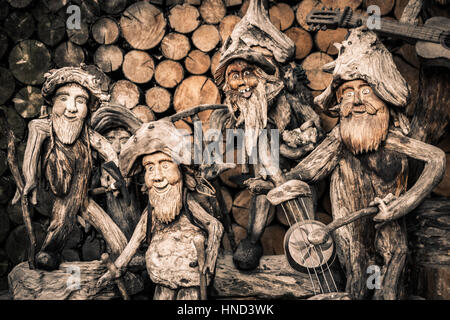 Lutago, Italy - December 23, 2016: Exposition of Sculpture roots, representatives musicians with their instruments - Stock Photo