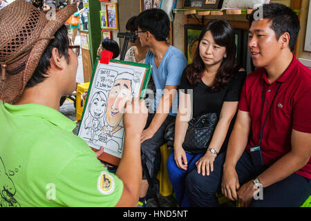 cartoonist, in Samil daero street,Seoul, South Korea - Stock Photo